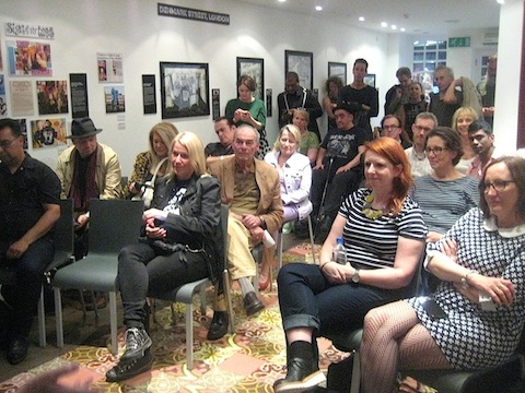 A packed gallery listening to stories about Johnsons and La Rocka!